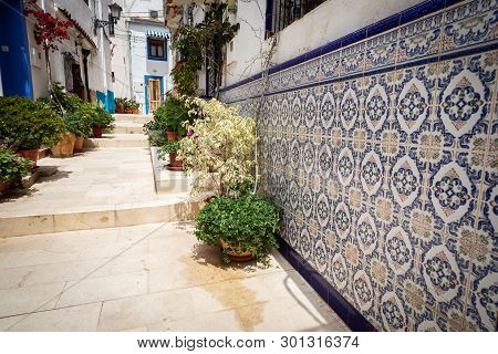Tipical Spanish Tile On The House In A Street Of Santa Cruz Disctrict, Alicante, Spain
