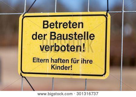 German Construction Side Sign On A Fence. Betreten Der Baustelle Verboten. Eltern Haften Für Ihre Ki