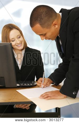 Business People Making A Deal In Office