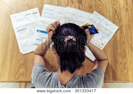 Top View Of Stressed Young Sitting Asian Woman Hands Holding The Head Worry About Find Money To Pay