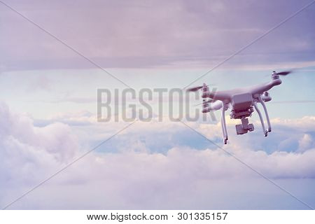 UAV drone multicopter flying with high resolution digital camera. The drone with professional camera takes pictures of the environment