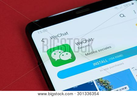 New York, Usa - May 15, 2019: Installing Wechat Messenger  On Smartphone Screen Close Up