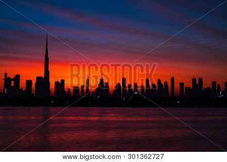 Mythical Bloody Red Sky Over Dubai. Dawn, Morning, Sunrise Or Dusk Over Modern City. Beautiful Color