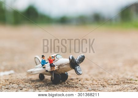 Miniature People: Couple Sitting On The Airplane , Exploring The World Concept