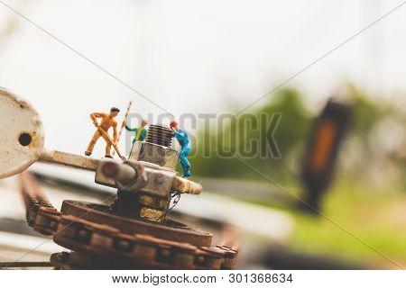 Miniature People : Mechanics Repairing Bicycle  , Concept Of The Workshop