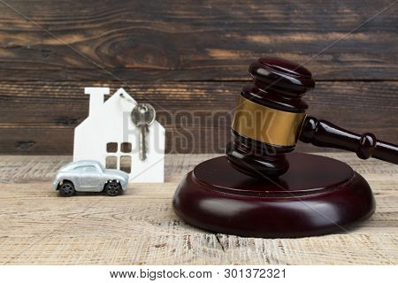Wooden House, Car Judges Gavel On Wooden Background. Purchase, Sale Of Real Estate. Housing.