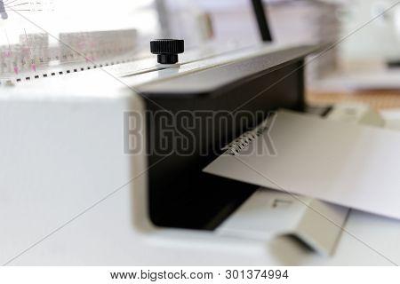 Book Binding Machine.  Work With Book Binding Machine. Printing Equipment.