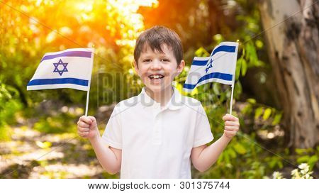 Israeli Happy Boy Hold and Waving Israeli Flag On Independence Day,  Sunny Day