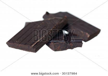 Pile Of Dark Chocolate On White Background.