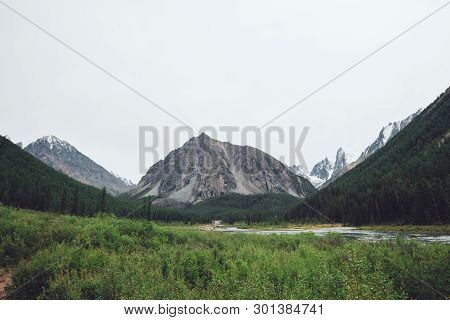 Mountain Creek In Valley Against Giant Mountains And Snowy Tops. Water Stream In Brook Against Glaci