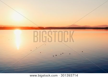 Sea landscape. Summer sunny water sea scene. Sea harbor - summer nature with mountain range at the horizon