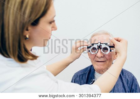 Optometrist Making An Eye Test To A Senior Man.visual Impairment Aged People