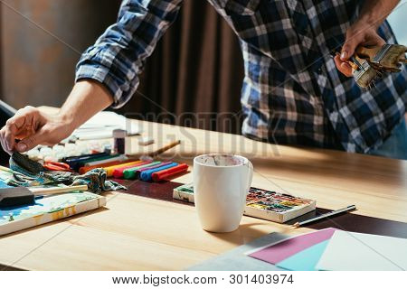 Artist Tools. Paints Paintbrushes Markers. Man Cropped Shot. Art Studio Workplace. Creative Process