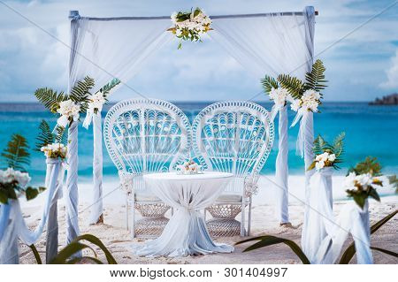 Beach Wedding Arch Gazebo Ceremonial Decorated With White Flowers On A Tropical Grand Anse Sand Beac
