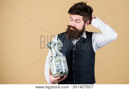 What Is A Good Way Of Investing Money. Bearded Man Thinking Of Investing Money Into Business. Busine