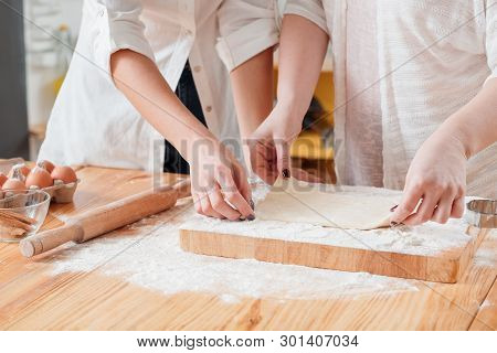 Women Baking. Mother Daughter Making Flat Dough. Sweet Home Baked Foods Goods Pastries Hobby. Cookin