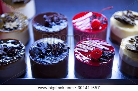 Background With Close Up Of Decorated Cakes