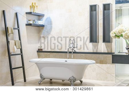 Spacious And Bright Modern Bathroom With White Tile, Large Mirror, Bathtub And Shower Cabin