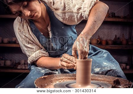 Charming Ceramist Woman Shows How To Work With Clay And Pottery Wheel. Making Ceramic Dishes.