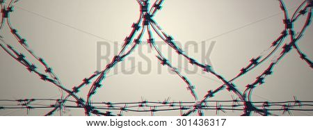 Barbed Wire On Country Border. Barbwire On Fence For Prohibition Of Illegal Aliens Crossing. Glitch