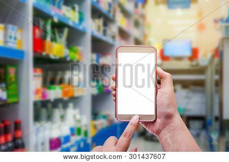 Pharmacy And Drugstore Concept, Hand Women Using Smart Phone White Screen In Pharmacy Store On Blurr