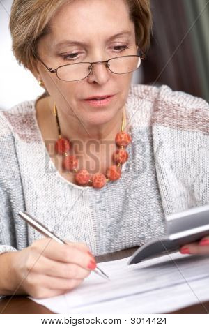 Female Calculating Taxes