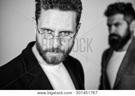 Eye health and sight. Optics and vision concept. Smart glance. Accessory for smart appearance. Wearing glasses may really mean you are smarter. Man handsome bearded mature guy wear eyeglasses poster