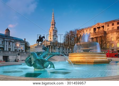 London, England - April 30, 2013: Fountain On The Trafalgar Square Early In The Evening With St. Mar