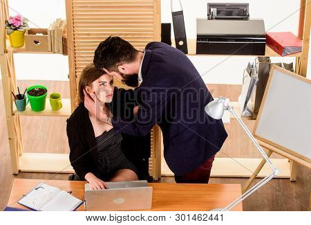 A Little Passion At Work. Love Affair Of Bearded Man And Sexy Woman In Office. Couple In Love Conduc