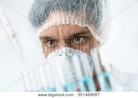 Keen Scientist With Brown Eyes In Protective Wear Performs Protein Assay