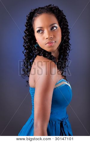 Young Beautiful African American Woman In Blue Dress