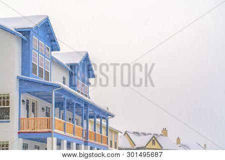 Exterior Of An Appealing Home In Daybreak Utah Against Cloudy Sky In Winter