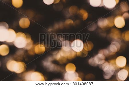 Abstract Bokeh Background. Christmas Glittering Golden Background
