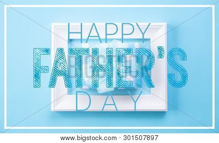 Happy Fathers Day Concept. Top View Of Picture Frame And Gift Box With Happy Father's Day Text On Bl
