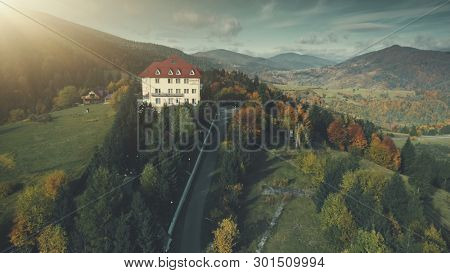 Epic Highland Hotel Mountain Forest Aerial View. Wild Nature Sight Clean Natural Environment. Asphalt Hill Road. Travel, Rest, Relax, Tourism, Recreation Concept