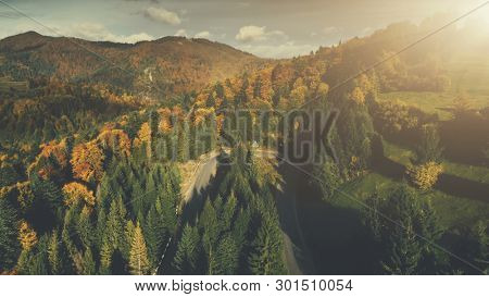 Colorful Rocky Landscape Dense Forest Aerial View. Majestic Wild Mountain Scenery Long Countryside Rural Road Overview. Beauty Highland Nature Travel Concept Timelapse Drone Flight