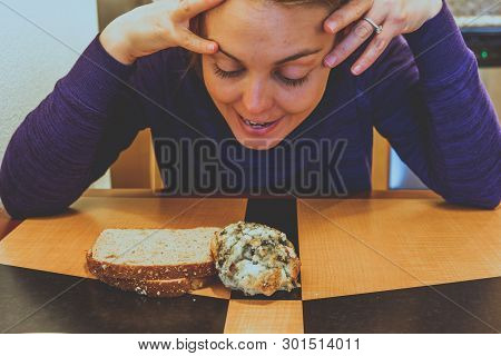 Happy Yet Undecided Young Adult Woman Decides Between A Blueberry Scone Or A Piece Of Toast For Brea
