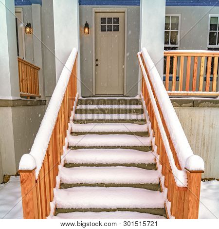 Clear Square Stairs Leading To The Front Porch And Door Of A Home In Daybreak Utah