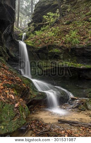 A Beautiful Ephemeral Waterfall Flows After Heavy Rains In A Hidden Rocky Ravine In The Hocking Hill