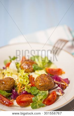 Colorful Fresh Vegetable Salad With Meatballs On Rustic Background.