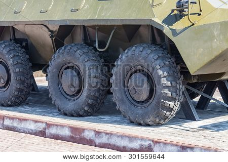 Close-up On Rubber Tires With A Large Tread To Overcome Impassable Roads And Dirt On A Russian-made