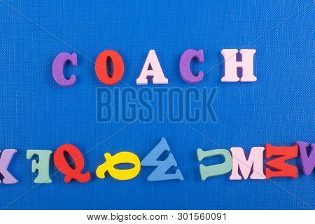 Coach Word On Blue Background Composed From Colorful Abc Alphabet Block Wooden Letters, Copy Space F