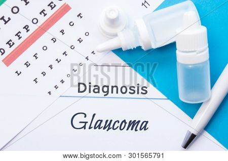 Ophthalmology Diagnosis Glaucoma. Snellen (eye) Chart, Two Bottles Of Eye Drops ( Medications) Lying