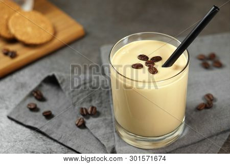 Cold Coffee Cream Milkshake Smoothie Drink In A Glass Topped With Coffee Beans On A Grey Rustic Tabl