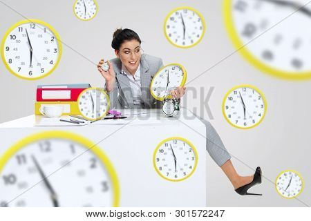 Young woman cant wait to go home from the nasty office. Holding the clock and waiting five minutes before the end. Concept of office workers troubles, business or problems with mental health. poster