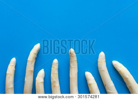 Seasonal White Asparagus Flat Lay On Blue Background With Copy Space