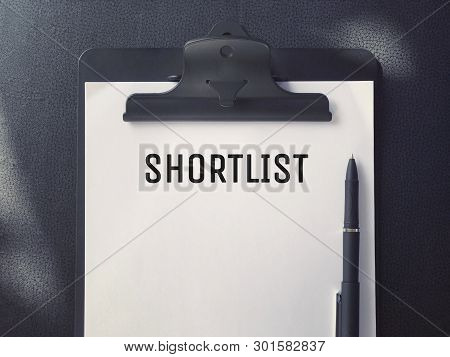 Business Or Job Hiring Concept - Top View Of A Clipboard And White Sheet With Shortlist Written On I