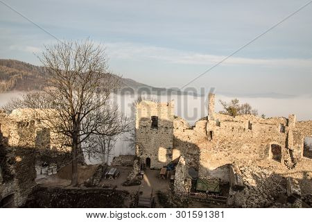 Ruins Of Povazsky Hrad Castle Above Povazska Bystrica City In Slovakia With Tree Snd Hill On The Bac