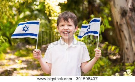 Israeli Happy Boy Hold and Waving Israeli Flag On Independence Day