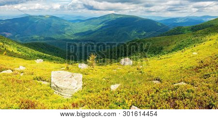 Rocks On The Grassy Hill. Beautiful Summer Panorama In Mountains. Cloudy Sky Above The Ridge. Wonder
